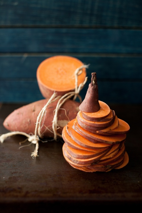 2. Slice the sweet potato into very thin rounds using a mandoline slicer.