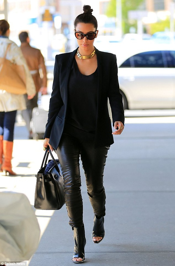 Kim Kardashian steps out in leather trousers for 3rd time in 48 hours as she heads to Washington DC