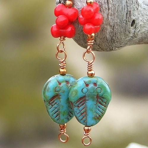 """Ancient Daze"" handmade earrings featuring Picasso finish turquoise colored Czech glass trilobites, red cral barbells, copper and sterling silver French hook earwires."