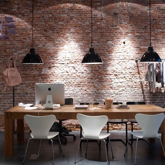 Big fat wooden table, brick wall, emaille lamps, linoleum floor