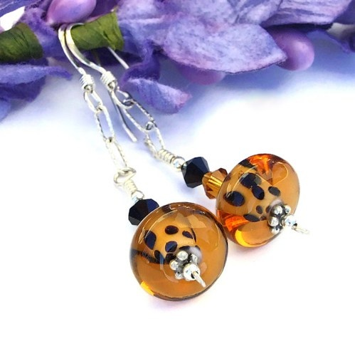 In this photo, you can see the breathtaking glow of the lampwork glass when the light hits them just right.