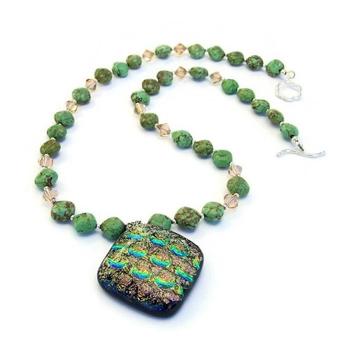 """Magical"" handmade artisan necklace created with a colorful dichroic glass pendant, green magnesite diamonds, peach Swarovski crystals and sterling silver."
