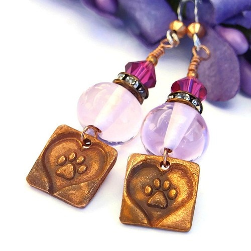 Perfect handmade earrings for anyone who loves their dog: created with artisan copper paw print and heart charms, pink lampwork beads, copper Czech crystal rondelles, fuchsia Swarovski crystals and sterling silver earwires.