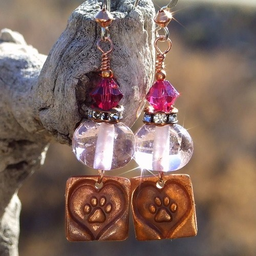 """""""Pretty Paws"""" handmade dog rescue earrings with hearts and paw prints. Just look at the way the earrings sparkle in the sun!"""