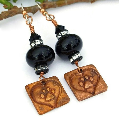 The copper paw print and heart charms used in the handmade earrings were individually artisan created from copper precious metal clay. Each charm is unique.