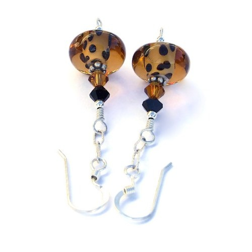 "The ""Go Wild"" handmade leopard spot lampwork glass and Swarovski crystal earrings shown from the top. Two Swarovski crystals complement the lampwork beads: one in ""jet"" black and one in ""topaz""."
