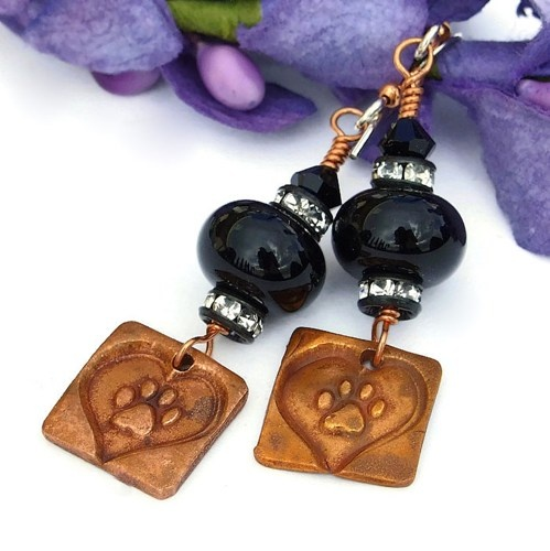 Unique handmade dog rescue handmade earrings created with artisan copper paw print and heart charms, artisan black lampwork glass beads, Czech crystal rondelles, Swarovski crystals, copper and sterling silver.