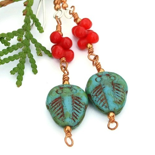 Uniquely whimsical and fun handmade earrings created with turquoise color fossil trilobite Czech glass beads, red coral barbells, copper and sterling silver.