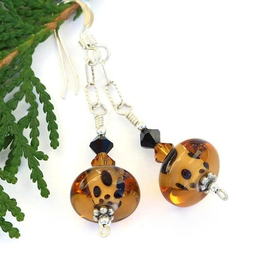 Walk on the wild side wearing these unique handmade earrings created with leopard spot lampwork glass beads, Swarovski crystals and sterling silver.