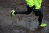 Dreckiges Running-Outfit nach einem Lauf bei nasskaltem Wetter