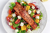 Summer delight: Grilled salmon with lemon and herb marinade