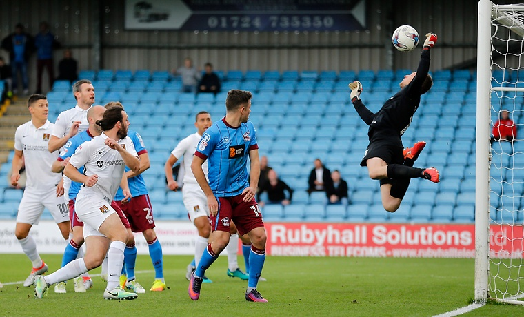 Adam Smith of Northampton Town Makes a diving save.