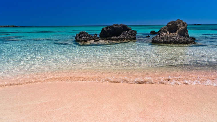 Makes This Place So Special Is Its Gorgeous Beach Of White Sand With Hints Pink Hue Caused By Particles Shells And Corals