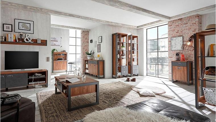 monochromes wohnzimmer in grau mit beton granit couchtisch im der charmante industrie